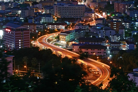 aerial view of Freeway Light trail to City at dusk in Pattaya, Thailand photo