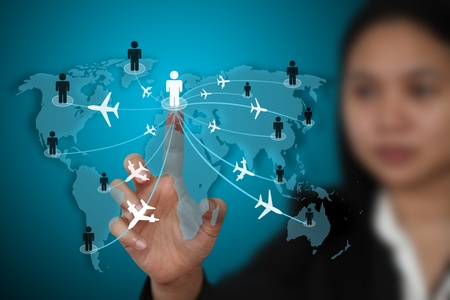 group travel: businesswoman touch on virtual screen for world business travel transport concept (selective focus on finger)