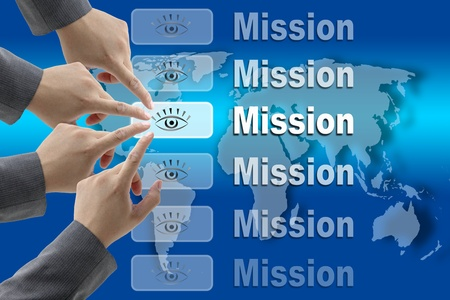 vision problems: business team pushing on Mission button with world map background