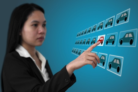 woman touch on screen interface to finding her new car from internet for e-commerce concept (selective focus on finger) photo
