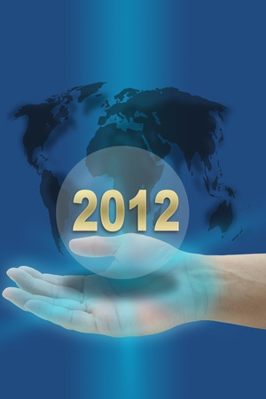 hand hold Happy New Year 2012 with world map photo