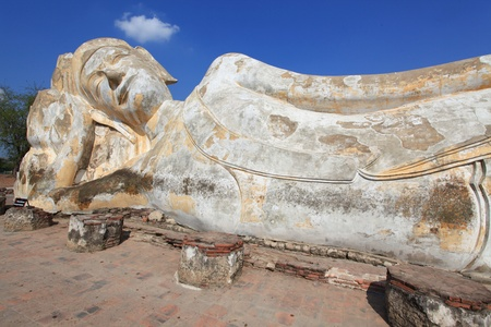 giant reclining buddha statue over blue sky photo