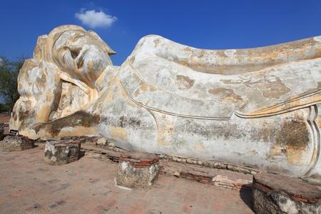 reclining: giant reclining buddha statue over blue sky