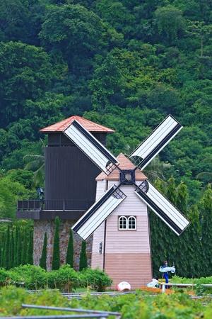 Historic windmill on the Fields at Pattaya, Thailand photo