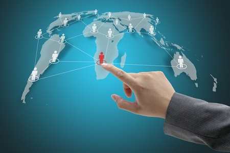 Business Hand Touch on Social Network Concept with World Map photo