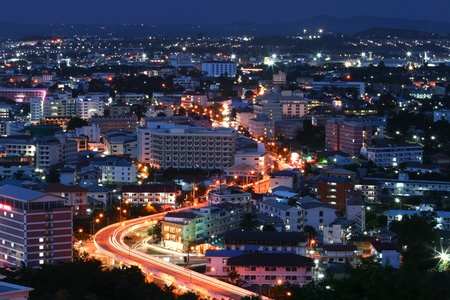 busy city: aerial view of Freeway Light trail to City at dusk in Pataya, Thailand Stock Photo