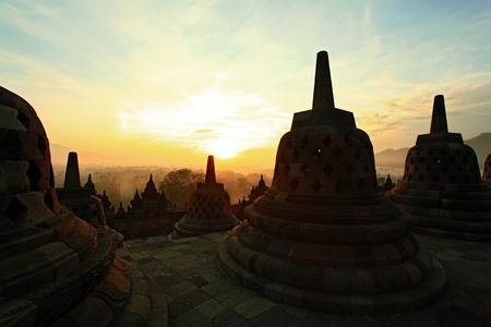 yogyakarta: Silhouette of Ancient stupa Borobudur Temple, with sunrise in Yogyakarta, Java, Indonesia.