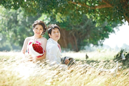 couples outdoors on windy grass photo