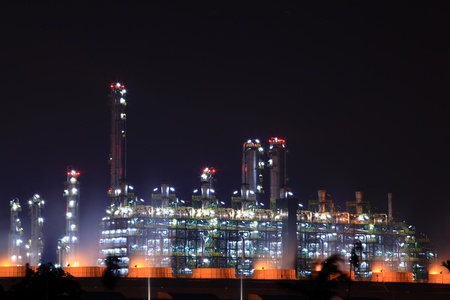 outdoor lighting: closeup of oil refinery factory at night Stock Photo