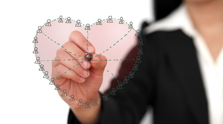 Asian business woman drawing Social Network in Love Concept (selective focus) photo