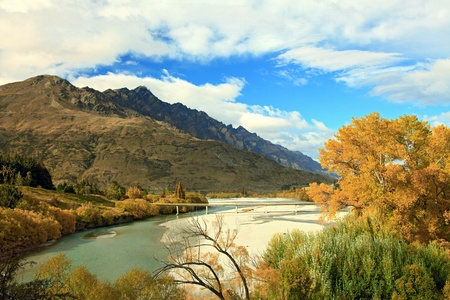 River and Lake From Historic Bridge with Mountain Landscape in Queenstowns New Zealand photo