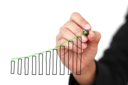 increases: Business Hand Drawing Sales Uptrend Graph Isolated (Selective focus on pen and graph) Stock Photo