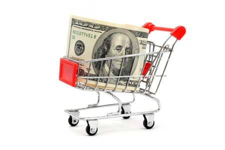 Money Dollar Cash Banknote in Trolley Shopping Cart on White Background photo
