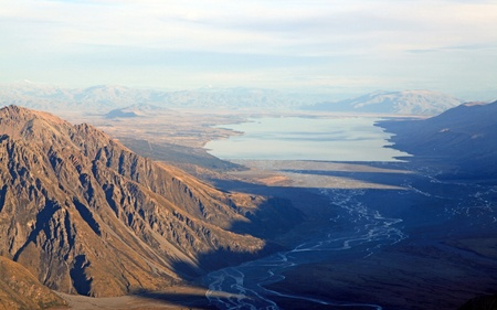 Aerial View of Tasman Glacier River to Lake Pukaki from Helicopter Mount Cook National Park New Zealand photo