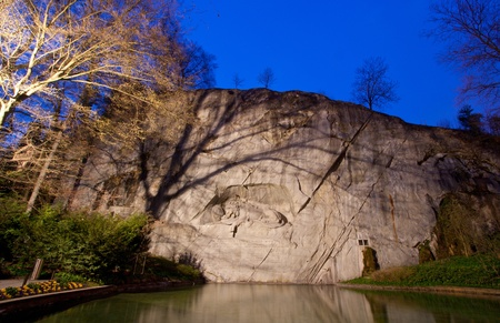 Dying Lion Monument Statue Landmark in Lucern Switzerland twilight
