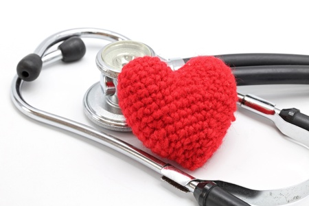 Perspective of Stethoscope and Red Heart on White Background using as Valentine Love Concept (Selective focus on Hearth) photo