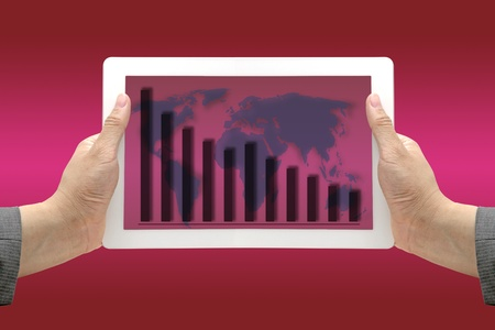 regression: Hand Hold Technology  Touch Screen Pad Interface with Down Trend Revenue Graph using as Business Regression Concept