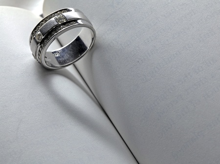 Wedding Luxury Diamond ring casting a heart on Book Using for Love never ends Concept in Valentine Holiday photo