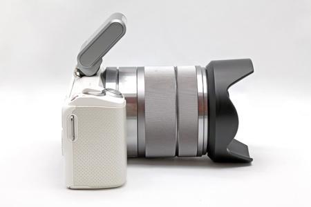 studio photography: Micro Forth Third DSLR Digital Camera Stock Photo