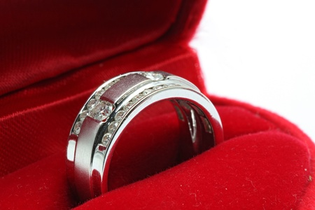Macro shot of Luxury Wedding Diamond Ring in Red Box photo
