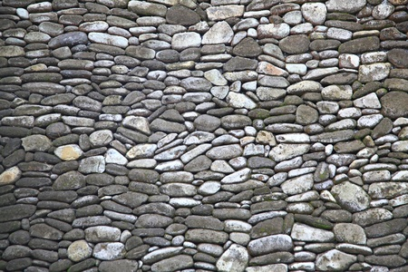 Traditional Stone Brick Wall Fragment Stones in Irregular Shapes photo