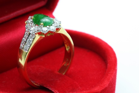 Macro shot of Luxury Wedding Jade Diamond Ring in Red Box photo