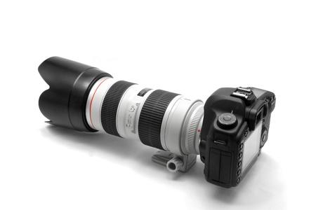 reflex: Professional DSLR Digital Camera with Big White Tele Lens on White Background Stock Photo