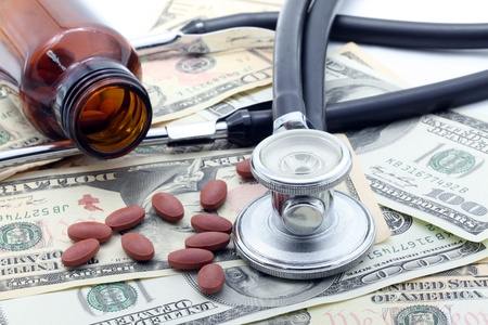 Medical Stethoscope and Pills on Dollars photo