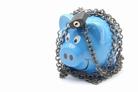 padlocked: Piggy bank padlocked with chains and padlock on white background for Money Insurance Concept