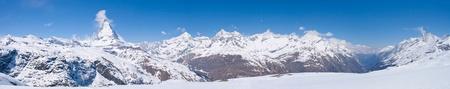 Panorama of Snow Mountain Range Landscape at Matterhorn Peak Alps Alpine Region Switzerland photo