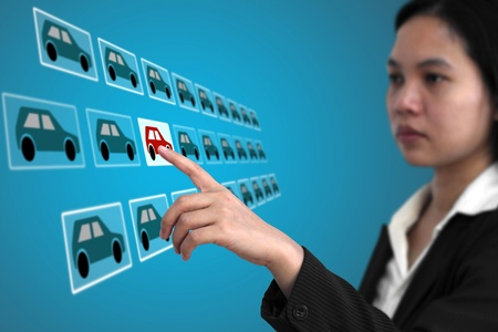 woman touch on screen interface to finding her new car from internet for e-commerce concept (selective focus on finger) Stock Photo - 12331779