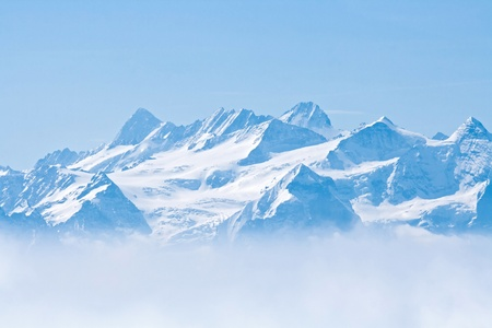 Landscape of Snow Mountain with Blue Sky from Pilatus Peaks Alps Lucern Switzerland photo