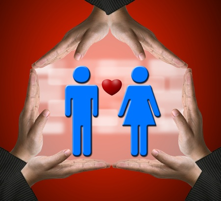 Hands showing Home sign with Male and Female in love using for Sweet home conceptual photo