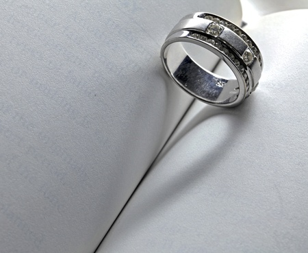 Wedding Luxury Diamond ring casting a heart on Book Using for