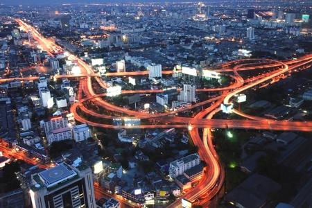 The highest Aerial view of Bangkok Highway at Dusk in Thailand photo