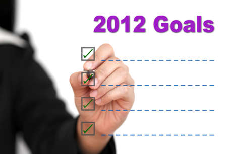 Asian business woman writing 2012 Goal List photo