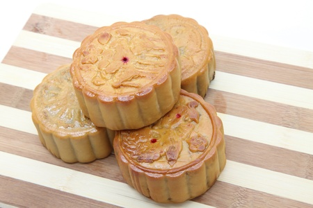 Chinese Moon cake on wooden dish photo