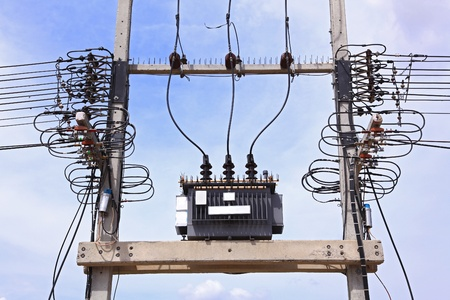 amp tower: Electric transformer against Blue Sky Stock Photo