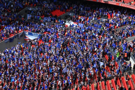 LONDON - APRIL 14 : Supporters watch the football game of Liverpool - Everton Semi Final FA Cup Crowd at Wembley Arena Stadium on April 14, 2012 in London, England United Kingdom.