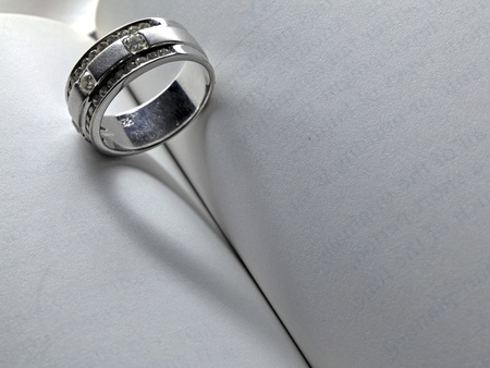 Wedding Luxury Diamond ring casting a heart on Book Using words LOVE NEVER ENDS, Concept in Valentine Holiday photo