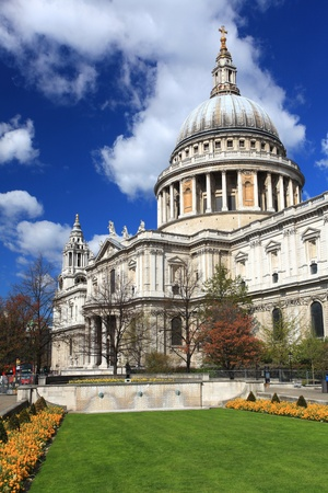 St. Paul Cathedral with green garden in London England United Kingdom photo