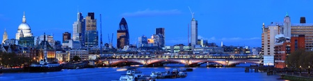 skylines: Panorama St. Paul Cathedral and Skylines From Waterloo Bridge along River Thames in London England United Kingdom Stock Photo