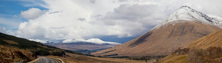 Panorama Empty Countryside Road Highway of Highlands Scotland with Beautiful Snow Mountain Range photo