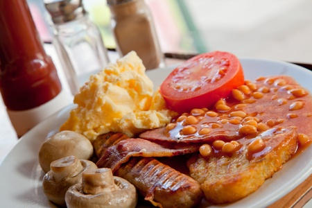 bacon baked beans: Full English Breakfast on Table with ketchup