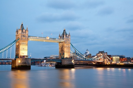 London Tower Bridge along River Thames, England UK at Dusk photo