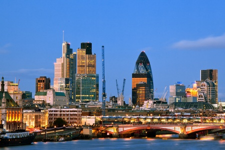 London Skylines Skyscrapers along River thames at dusk England UK photo