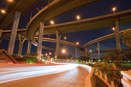 cross road: Architecture of Mega Bhumibol Industrial Ring Bridge at dusk in Thailand. Stock Photo