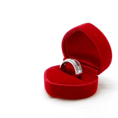 isolated male diamond ring in red valvet box photo