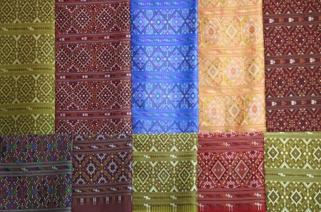 thailand silk: pieces of colorful praewa silk fabric cloth using as background Stock Photo
