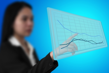 business woman touch up trend graph on virtual interface (Selective Focus at finger) Stock Photo - 13759388